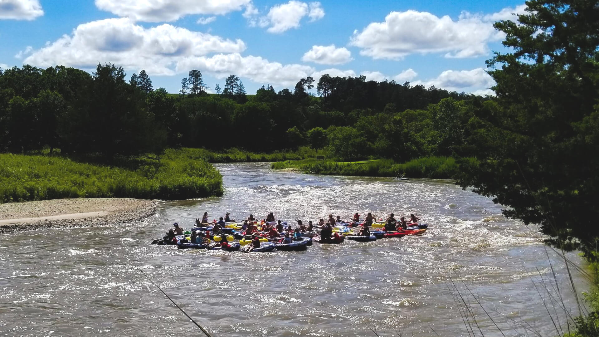 20 tubes with people on them floating down the Niobrara River